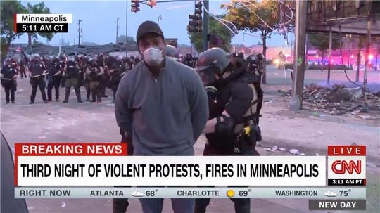 In this screengrab from CNN, reporter Omar Jimenez is detained by police officers on May 29, 2020 in Minneapolis.