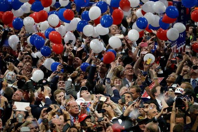 In this July 21, 2016, file photo, confetti and balloons fall during celebrations after Republican presidential candidate Donald Trump's acceptance speech on the final day of the Republican National Convention in Cleveland.