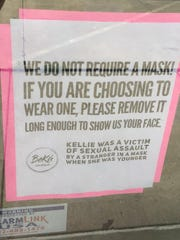 A sign on the door of Kellie Johnson's store in Lincoln, Neb., bucks the trend of requiring patrons to wear masks.