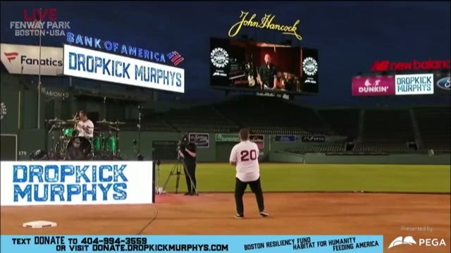 Bruce Springsteen, on the scoreboard, virtually joins the Dropkick Murphys  at Fenway Park in Boston on May 29, 2020.