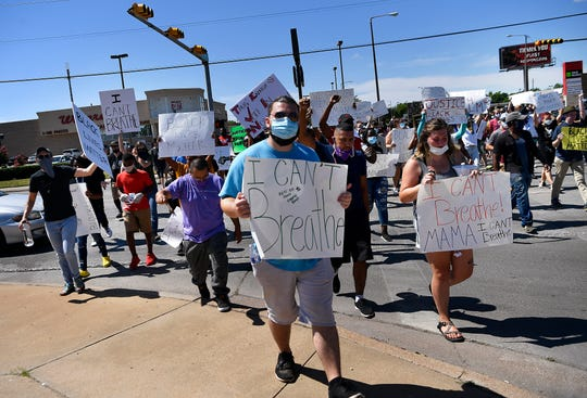 Activists cross South 14th Street at Barrow Street during the March for Floyd Saturday. The group of around 200 people marched just over 5 miles through mid-Abilene in memory of George Floyd and others who have died at the hands of police officers nationwide.