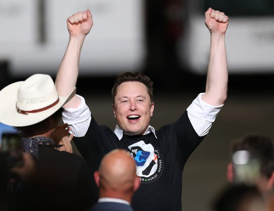 CAPE CANAVERAL, FLORIDA - MAY 30: Spacex founder Elon Musk celebrates after the successful launch of the SpaceX Falcon 9 rocket with the manned Crew Dragon spacecraft at the Kennedy Space Center on May 30, 2020 in Cape Canaveral, Florida. Earlier in the day NASA astronauts Bob Behnken and Doug Hurley lifted off an inaugural flight and will be the first people since the end of the Space Shuttle program in 2011 to be launched into space from the United States.