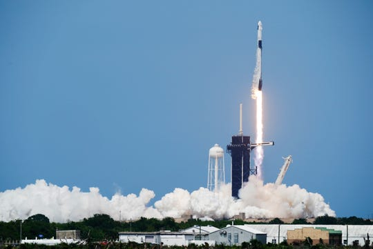 A SpaceX Falcon 9, with NASA astronauts Doug Hurley and Bob Behnken in the Dragon crew capsule, lifts off from Pad 39-A at the Kennedy Space Center in Cape Canaveral, Fla., Saturday, May 30, 2020. For the first time in nearly a decade, astronauts blasted towards orbit aboard an American rocket from American soil, a first for a private company.