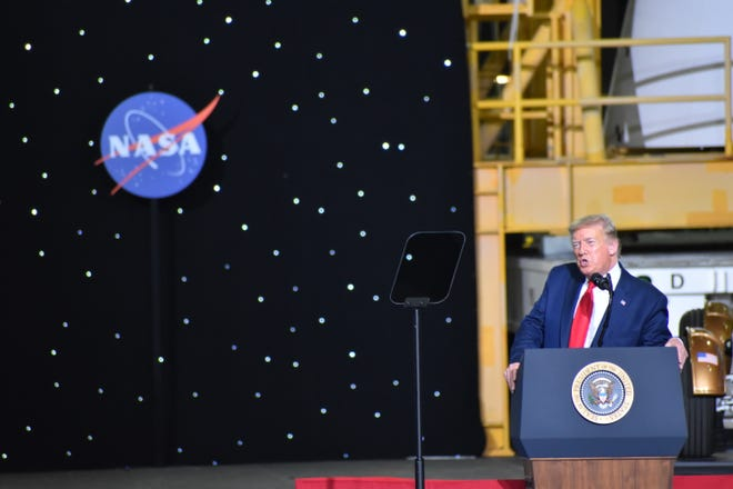 President Donald Trump speaks at Kennedy Space Center's Vehicle Assembly Building May 30, 2020. SpaceX launched NASA astronauts Bob Behnken and Doug Hurley on its Falcon 9 rocket and Crew Dragon capsule from pad 39A, marking the first time American astronauts are launched to space from U.S. soil in nine years.