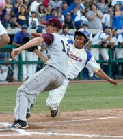 Moody Christian Gallegos steals home plate in front of pitcher Rob Zastryzny Thursday, June 4, 2009 during the first game of the Class 4A Region IV championships at Whataburger Field in Corpus Christi.