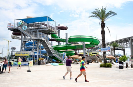 People attend Hurricane Alley's reopening, Saturday, May 30, 2020. The water park is taking measures to prevent the spread of coronavirus.