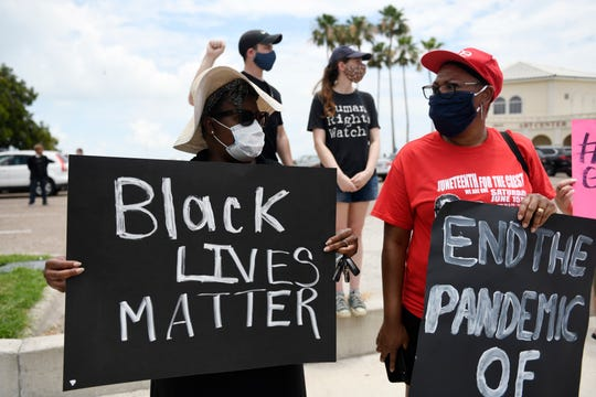 Protesters gather for a Stand in Solidarity for George Floyd, Saturday, May 30, 2020, in downtown Corpus Christi. About a 100 people  were protesting the death of George Floyd and the use of excessive force by police.