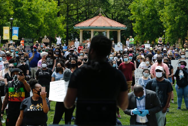 Hundreds gather for The People of Cincinnati Peaceful Protest at Washington Park Saturday, May 30, 2020. Protests have been sparked in Cincinnati and nationwide after George Floyd, a black man died Monday in Minneapolis, after a white police officer kneeled on his neck, ignoring Floyd's pleas that he could not breathe.
