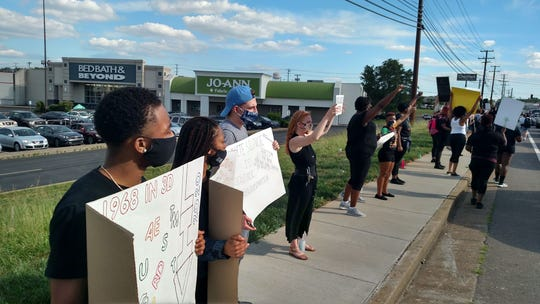 Hundreds of people line Wilma Rudolph Boulevard in Clarksville on Saturday, May 30, 2020, to protest the police killing of George Floyd in Minneapolis.