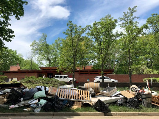 Piles of household debris line Valley Drive in Midland, Michigan, on Wednesday, May 27, 2020. The Central Michigan city, known for its midcentury modern architecture, was submerged after torrential rains overwhelmed two dams. Architecture enthusiasts worry how extensively the structures were damaged.
