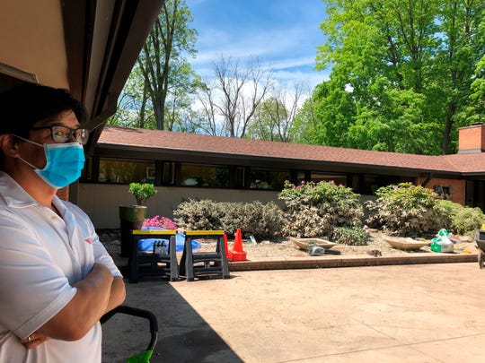 Christopher Jue examines the damage to his 1958 midcentury modern home on Wednesday, May 27, 2020, after floods inundated Midland, Michigan.