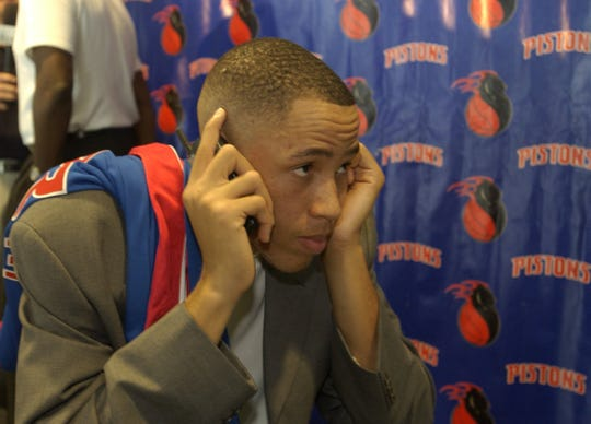 Tayshaun Prince, the Detroit Pistons' first-round draft pick, does an interview on his cell phone after a news conference at the Palace of Auburn Hills, July, 2, 2002.