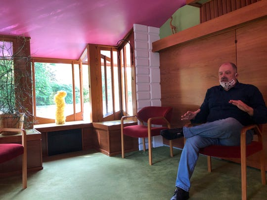 Craig McDonald, director of the Alden B. Dow Home & Studio, talks Wednesday, May 27, about the flooding that inundated many midcentury modern buildings in Midland, Michigan.