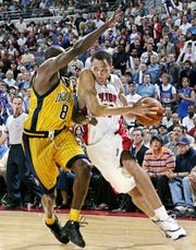 Pistons' Tayshaun Prince tries to drive past Indiana Pacers' Anthony Johnson during the second quarter in Game 6 of the Eastern Conference finals Tuesday, June 1, 2004 at the Palace of Auburn Hills.