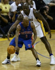Chauncey Billups is dwarfed by Shaquille O'Neal during the third quarter in Game 1.