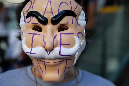 """A person wears a mask that says """"Black Lives Matter"""" during a protest of the death of George Floyd, Friday, May 29, 2020, in Las Vegas."""