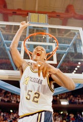 Terry Mills and Michigan beat Virginia to make the Final Four in 1989.