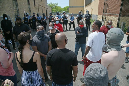 Protesters face off with police at the Minneapolis Police Third Precinctt, Thursday, May 28, 2020, after a night of rioting as protests continue over the arrest of George Floyd who died in police custody Monday night in Minneapolis after video shared online by a bystander showed a white officer kneeling on his neck during his arrest as he pleaded that he couldn't breathe.