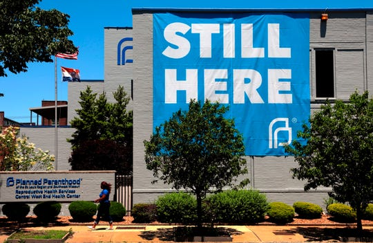 A banner hangs on the side of the Planned Parenthood of St. Louis building, Friday, May. 29, 2020 in St. Louis. Missouri's only abortion clinic will be able to keep operating after a state government administrator decided Friday that the health department was wrong not to renew the license of the Planned Parenthood facility in St. Louis.