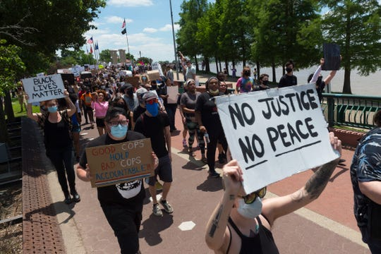 Hundreds march down Riverside Drive during an anti-violence protest in Evansville Saturday, May 30, 2020.