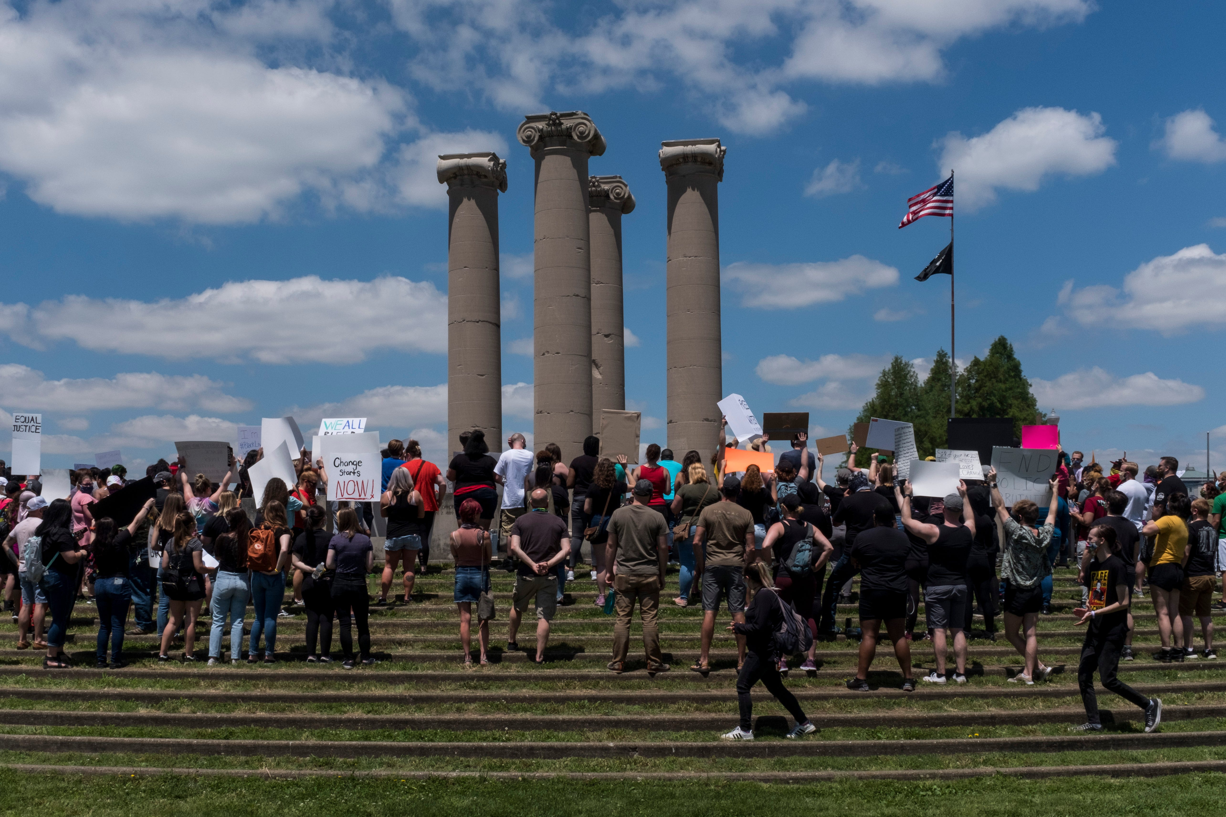 People gather for an anti-violence rally at the Four Freedoms Monument in Downtown Evansville, Ind., Saturday, May 30, 2020.