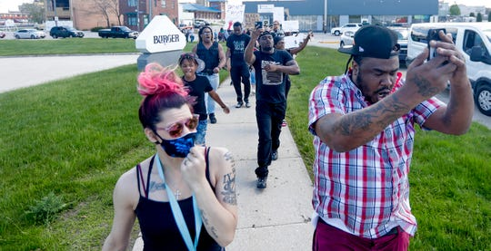 Protesters notice that traffic is stopped and decide to chant where they can be seen and heard in response to the death of George Floyd, who died in police custody on Memorial Day in Minneapolis.