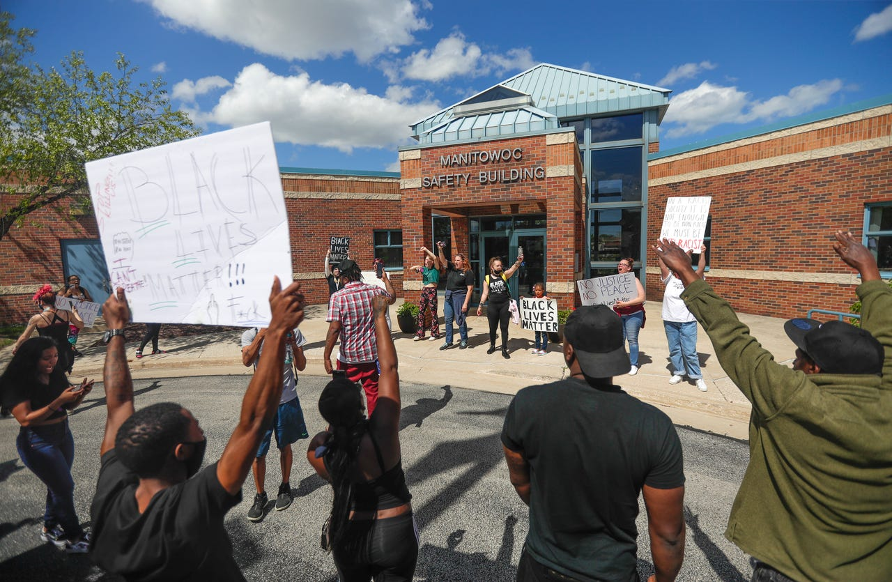Protestors chant and tell their stories about encounters with the police and the fears they have on Saturday, May 30, 2020, at the Manitowoc Police Department in Manitowoc, Wis. Ebony Cox/USA TODAY NETWORK-Wisconsin