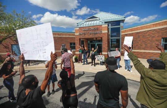 Protestors chant and tell their stories about encounters with the police and the fears they have on Saturday, May 30, 2020, at the Manitowoc Police Department in Manitowoc, Wis.