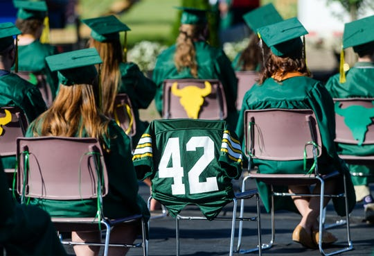 The CMR Class of 2020 honored their classmate David Delcomte, who died in swimming accident in July 2019, with a chair draped in his number 42 Rustler football jersey during Friday evening's graduation ceremony at Montana ExpoPark.