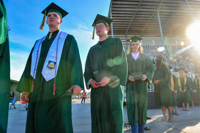 Graduates in the CMR Class of 2020 wait to have their official graduation photos taken during Friday evening's graduation ceremony at Montana ExpoPark.