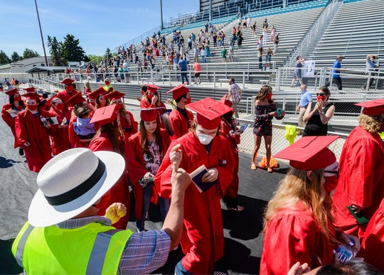 Paris Gibson Class of 2020 spring graduates walk passed faculty and staff at the conclusion of Saturday morning's graduation ceremony at Montana ExpoPark, May 30, 2020.