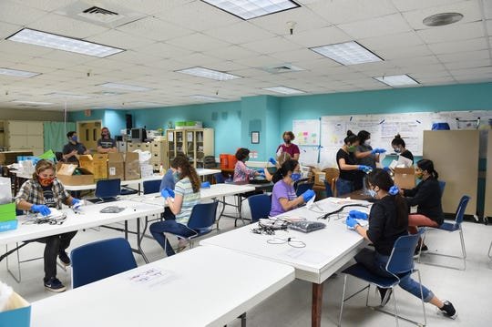 Volunteers for PPE for Guam help to repair 5,000 N95 masks from the U.S. Strategic National Stockpile at Guam Memorial Hospital in this May 30 file photo. Researchers  concluded that wearing of face masks in public corresponds to the most effective means to prevent human-to-human transmission of COVID-19.