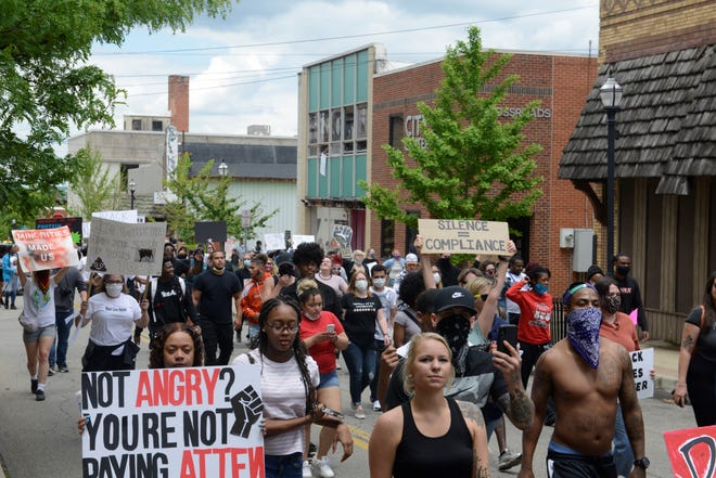 Dozens of people marched during Memorial Day weekend to protest the death of George Floyd and other Black men and women who've died during police encounters.