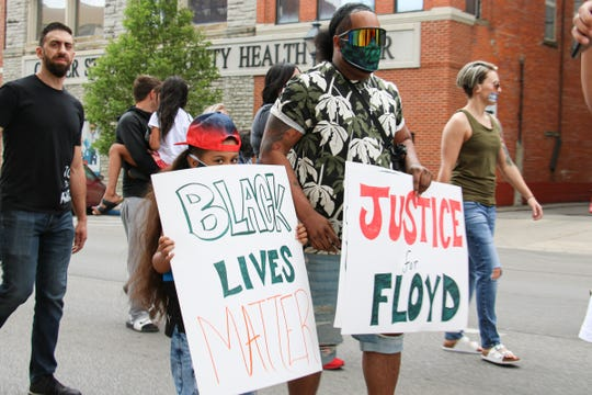 Kyle Emmerson calls for justice for George Floyd, a black man who died after a Minneapolis police officer pinned him with his knee against his neck, during a protest in Marion on Saturday. Emmerson said the officer should get the death penalty.