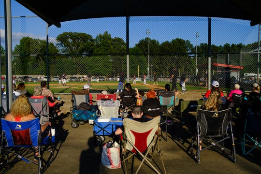 A crowd of family and friends watches a baseball game at Snowden Grove Park, Friday, May 29, 2020 in Southhaven, MS.