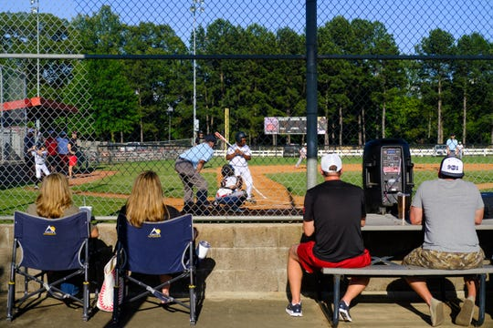 People watch as members of the Easley Baseball Club play the Germantown Baseball Club during the School's Out Celebration at Snowden Grove Park, Friday, May 29, 2020 in Southhaven, MS.