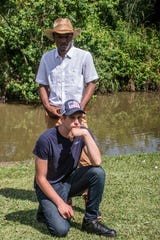 """Country singer Young DK, kneeling, of Prattville and hip hop artist Yung 808 of Montgomery have a new country/hip hop song """"Saddle."""""""
