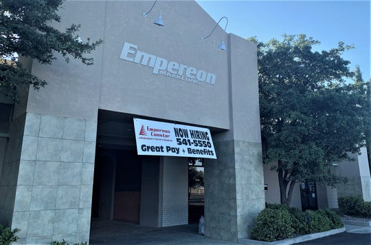 "Empereon Marketing, 2255 Main St., has announced it will be permanently closing. A ""Now Hiring"" banner remains in front of the call center on Saturday, May 30, 2020."