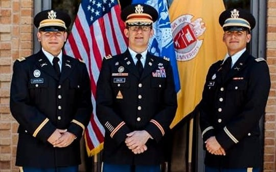 Newly commissioned officers 2nd Lt. Dominic LaVolpa, left, and 2nd Lt. Luis Peña with Lt. Col. George W. Childs III, professor of military science, during the New Mexico State University Army ROTC commissioning ceremony.