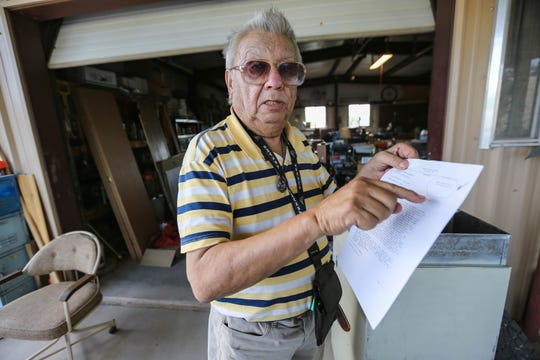 Eddie Bernal, 81, was diagnosed with COVID-19 and admitted to the hospital for 17 days. The virus affected his memory, he said. Here, Bernal shows his discharge papers while at his home in Las Cruces on Saturday, May 30, 2020, after he was released from the hospital on a bill of good health and tested clear from COVID-19.