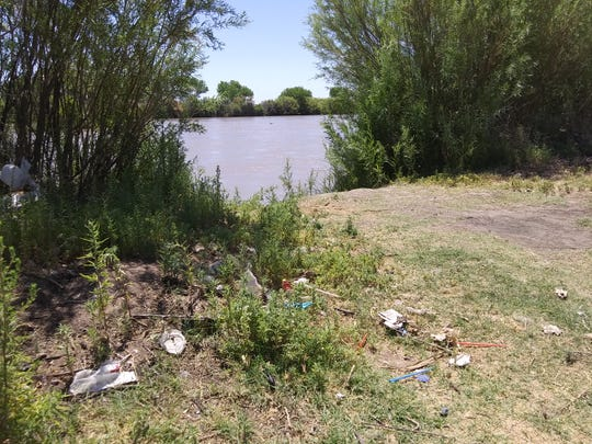 Trash is left behind on the banks of the Rio Grande.
