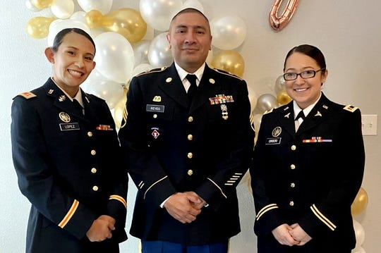 Newly commissioned officers 2nd Lt. Brisa Lopez, left, and 2nd Lt. Justice Cordero with Staff Sgt. Adan Reyes, Army Reserve 900th quartermaster company, at the New Mexico State University Army ROTC commissioning ceremony.