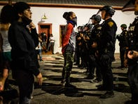 Protesters stand off against a line of officers from the Tucson Police Department at Cushing Street and Church Avenue on May 29, 2020. The protest in Tucson was similar to those in numerous cities across the United States following the police killing of George Floyd in Minneapolis earlier this week.