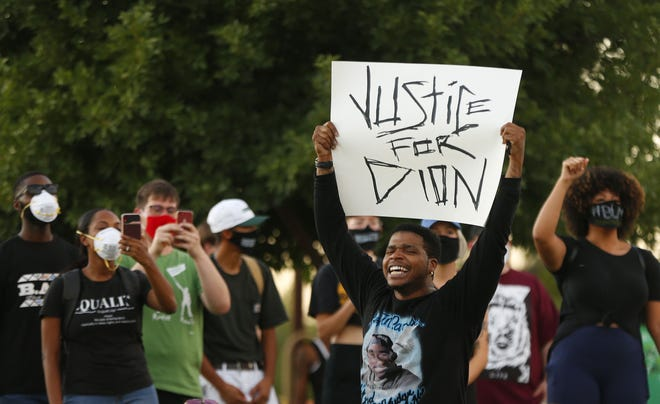 Protesters gather during a Justice for Dion Johnson rally at Eastlake Park in Phoenix on May 29, 2020.