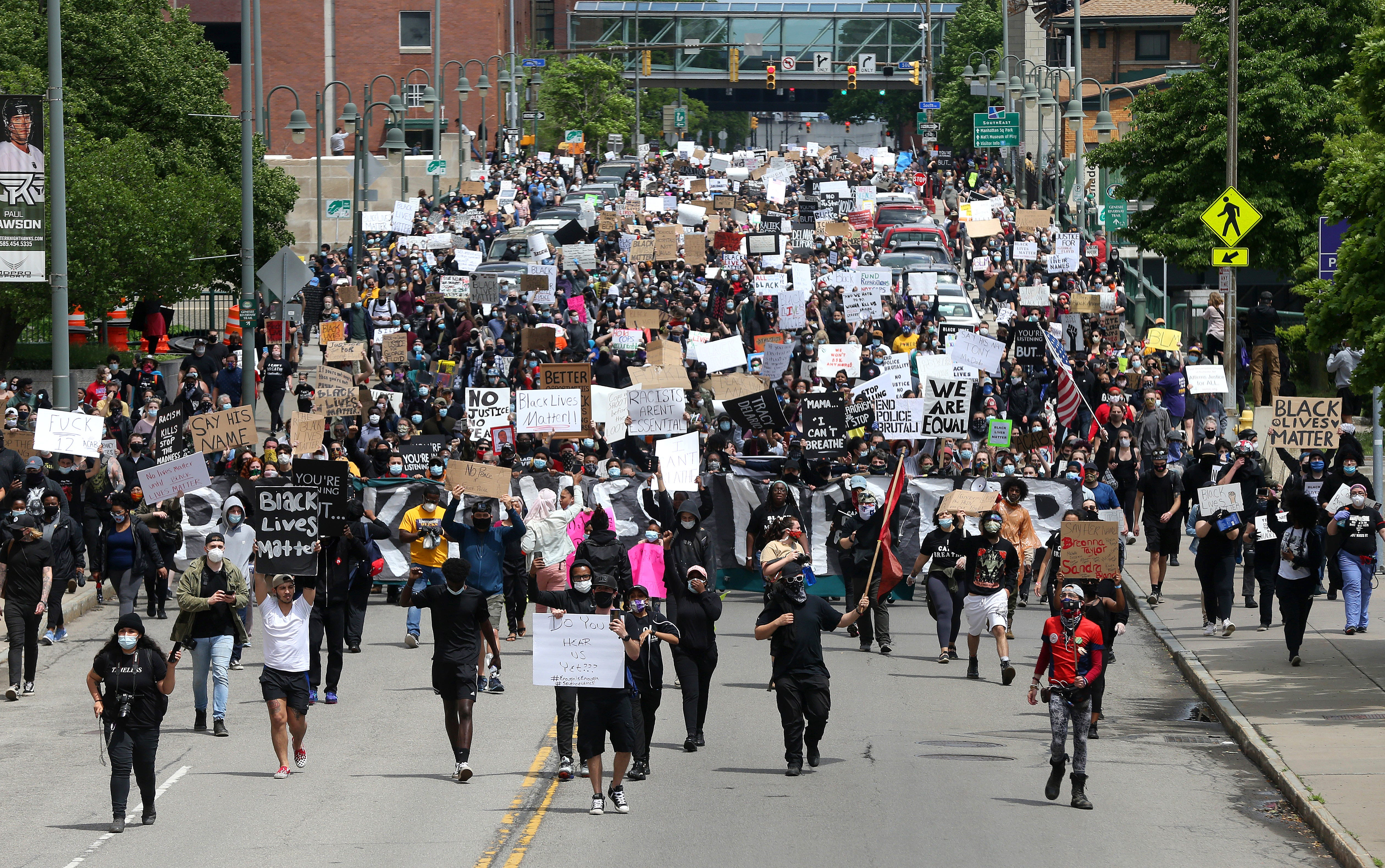 Several thousand protesters march on Court Street in downtown Rochester to the Public Safety Building and police headquarters, during a Black Lives Matter rally.