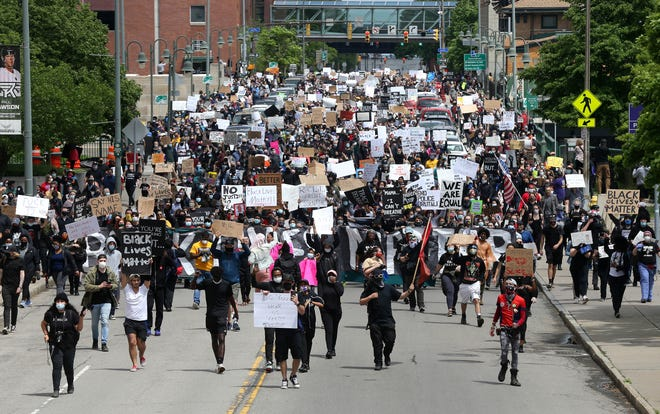Several thousand protestors march on Court Street in downtown Rochester to the Public Safety Building and police headquarters, during a Black Lives Matter rally.