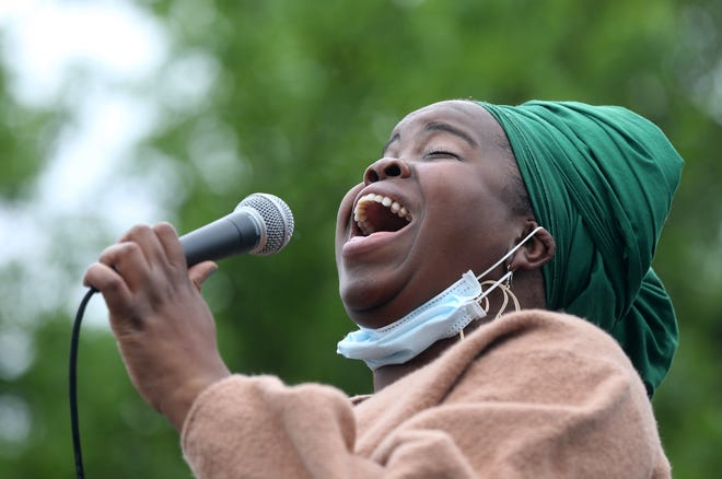 Danielle Ponder performs a song during a Black Lives Matter rally at Martin Luther King Jr. Memorial Park.