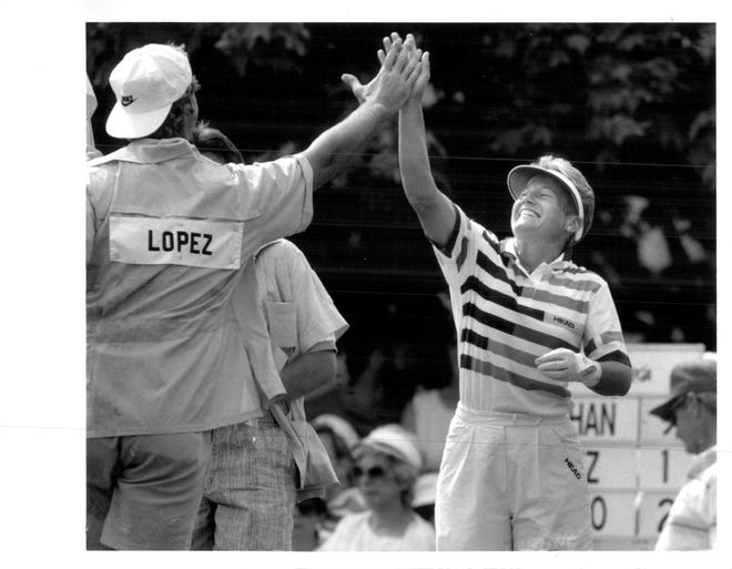Patty Sheehan receives a high-five from Nancy Lopez's caddie after she made a double eagle in the third round of the 1989 Rochester International.