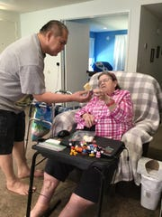 Shirley Madden depends on help from Felix Valbuena to live independently at home in Chatsworth, California. Gov. Gavin Newsom's proposed state budget would reduce the number of hours caregivers can work under the state's In-Home Supportive Services program.
