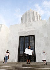 Jonathan Jones speaks during a vigil for George Floyd, Breonna Taylor and Ahmaud Arbery at the Oregon State Capitol in Salem, Oregon, on Friday, May 29, 2020.